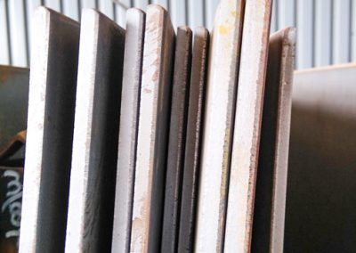 Metal sheets stacked upright